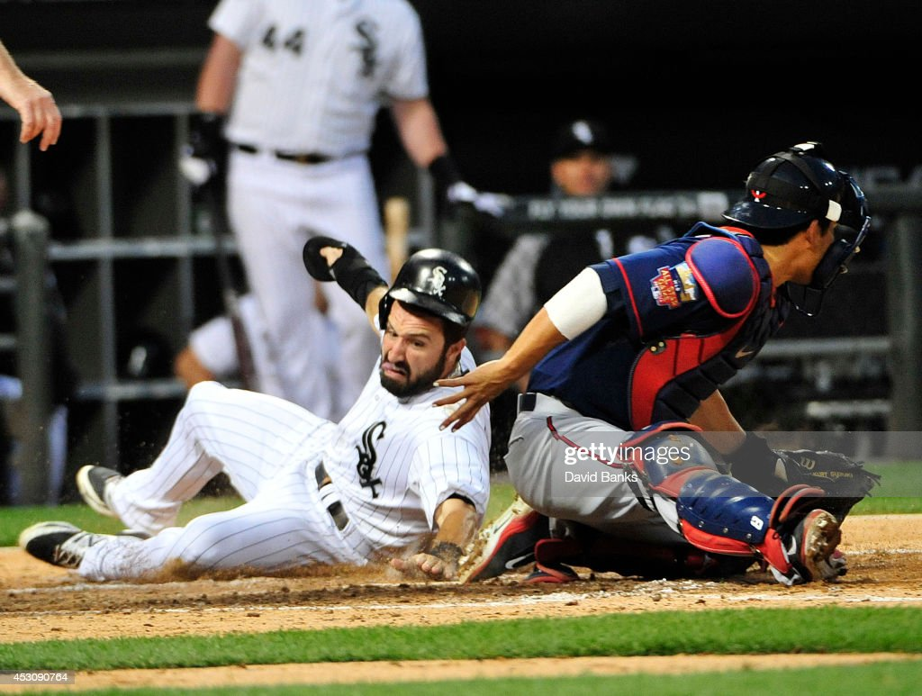 <a gi-track='captionPersonalityLinkClicked' href=/galleries/search?phrase=Adam+Eaton&family=editorial&specificpeople=210898 ng-click='$event.stopPropagation()'>Adam Eaton</a> #1 of the Chicago White Sox scores as <a gi-track='captionPersonalityLinkClicked' href=/galleries/search?phrase=Kurt+Suzuki&family=editorial&specificpeople=682702 ng-click='$event.stopPropagation()'>Kurt Suzuki</a> #8 of the Minnesota Twins makes a late tag during the seventh inning on August 2, 2014 at U.S. Cellular Field in Chicago, Illinois.