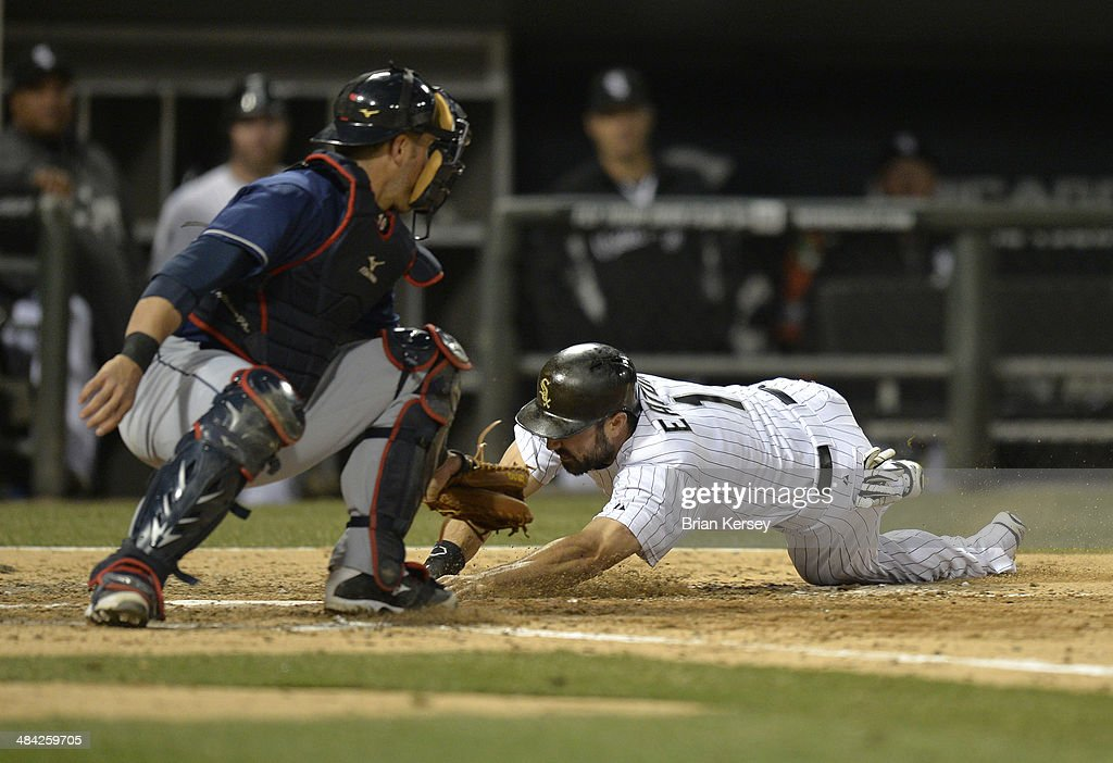 <a gi-track='captionPersonalityLinkClicked' href=/galleries/search?phrase=Adam+Eaton&family=editorial&specificpeople=210898 ng-click='$event.stopPropagation()'>Adam Eaton</a> #1 of the Chicago White Sox (R) scores past catcher <a gi-track='captionPersonalityLinkClicked' href=/galleries/search?phrase=Yan+Gomes&family=editorial&specificpeople=9004037 ng-click='$event.stopPropagation()'>Yan Gomes</a> #10 of the Cleveland Indians on an RBI single hit by Conor Gillaspie #12 during the fifth inning at U.S. Cellular Field on April 11, 2014 in Chicago, Illinois.