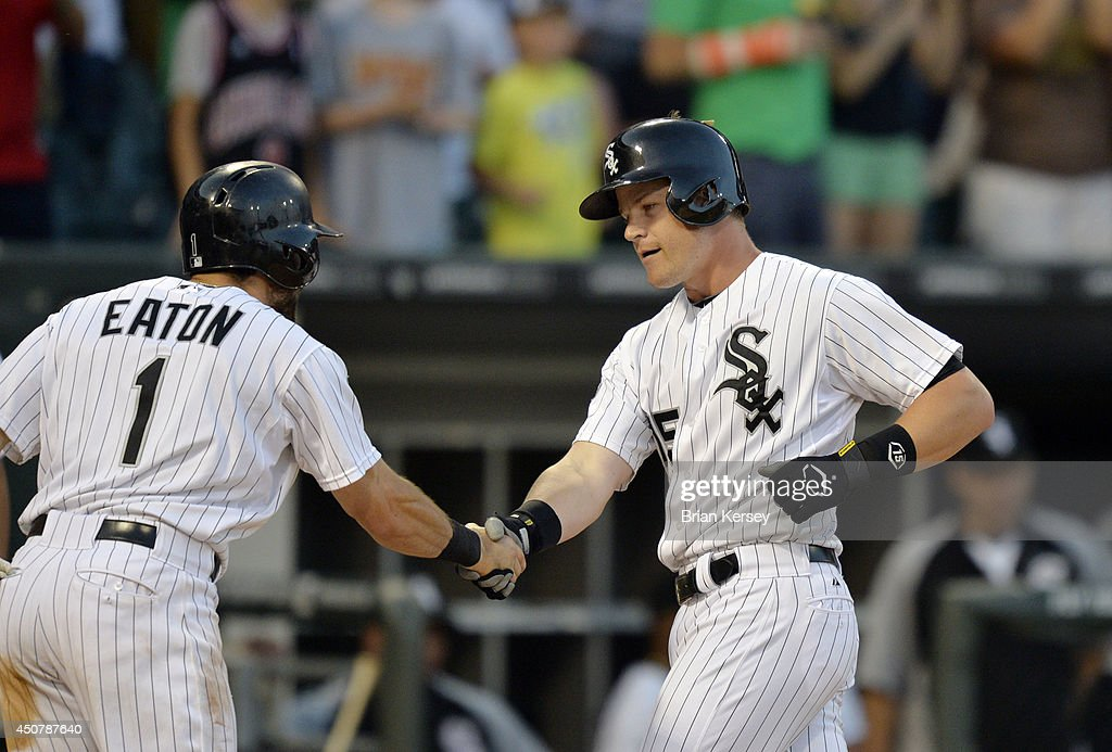 <a gi-track='captionPersonalityLinkClicked' href=/galleries/search?phrase=Adam+Eaton&family=editorial&specificpeople=210898 ng-click='$event.stopPropagation()'>Adam Eaton</a> #1 of the Chicago White Sox shakes hands with <a gi-track='captionPersonalityLinkClicked' href=/galleries/search?phrase=Gordon+Beckham&family=editorial&specificpeople=5411079 ng-click='$event.stopPropagation()'>Gordon Beckham</a> #15 at home plate after Beckham hit a two-run home run scoring Eaton during the third inning against the San Francisco Giants at U.S. Cellular Field on June 17, 2014 in Chicago, Illinois.