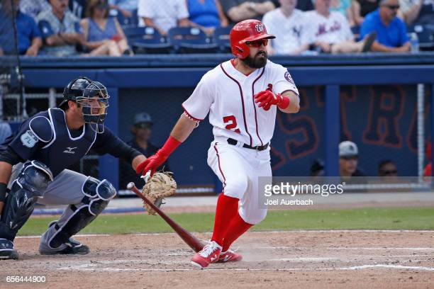Adam Eaton of the Washington Nationals hits the ball against the New York Yankees during a spring training game at The Ballpark of the Palm Beaches...