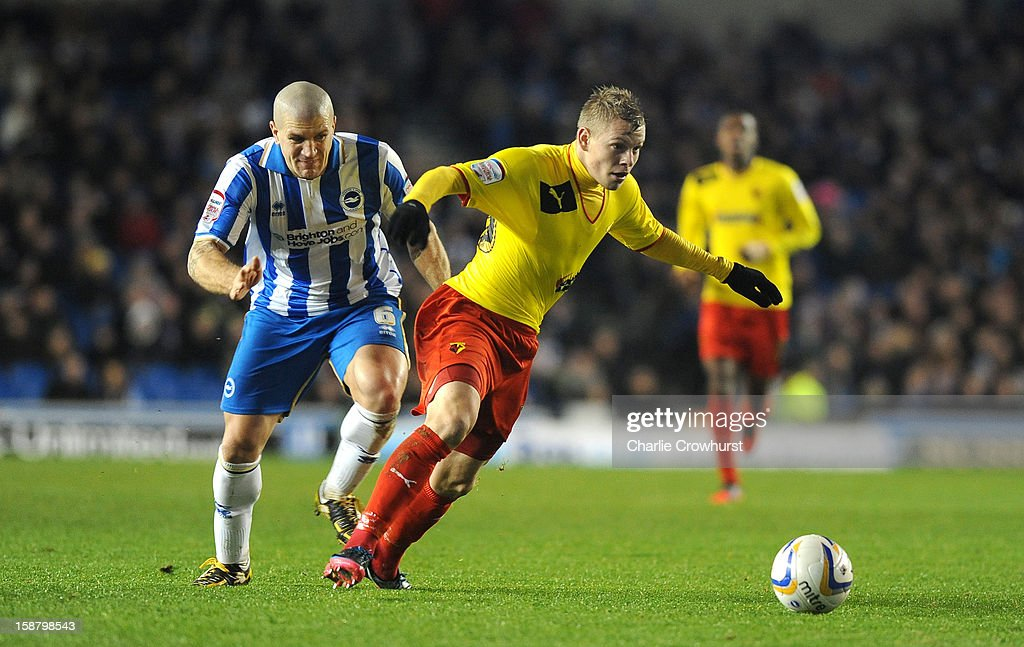 Adam El-Abd of Brighton & Hove Albion holds back Watford's Matej Vydra during the npower Championship match between Brighton & Hove Albion and Watford at The Amex Stadium on December 29, 2012 in Brighton England.