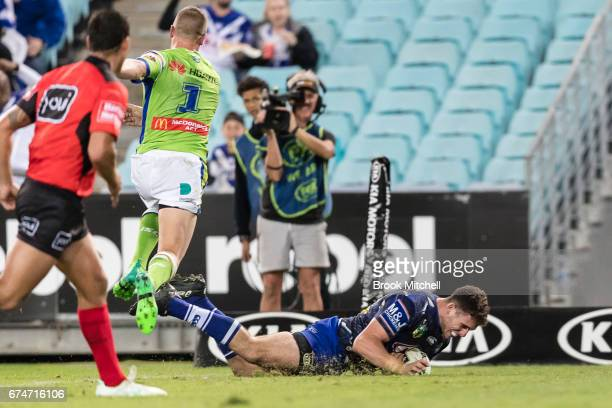 Adam Elliot of the Bulldogs slide in for a try during the round nine NRL match between the Canterbury Bulldogs and the Canberra Raiders at ANZ...