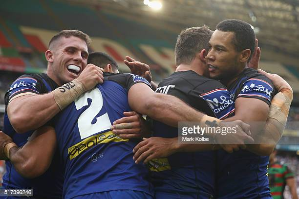 Adam Elliott Curtis Rona Josh Morris and Moses Mbye of the Bulldogs celebrate Curtis Rona scoring a try during the round four NRL match between the...