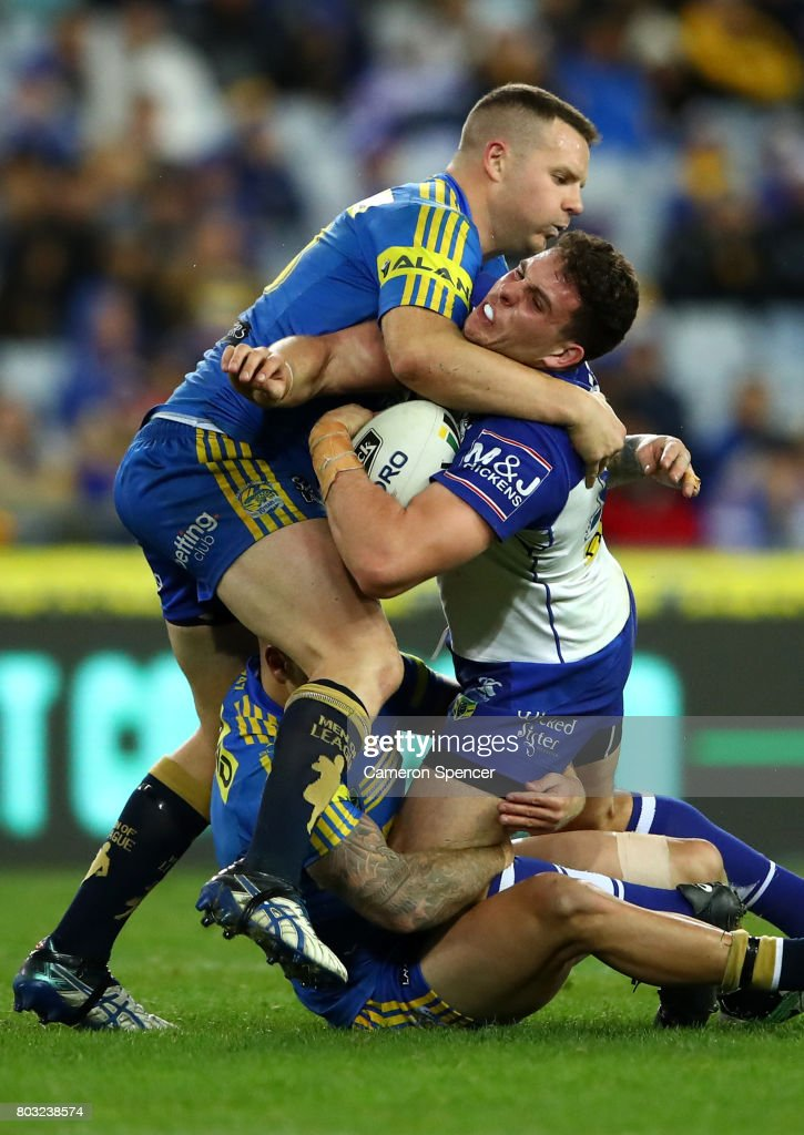 Adam Elliott of the Bulldogs is tackled during the round 17 NRL match between the Parramatta Eels and the Canterbury Bulldogs at ANZ Stadium on June 29, 2017 in Sydney, Australia.