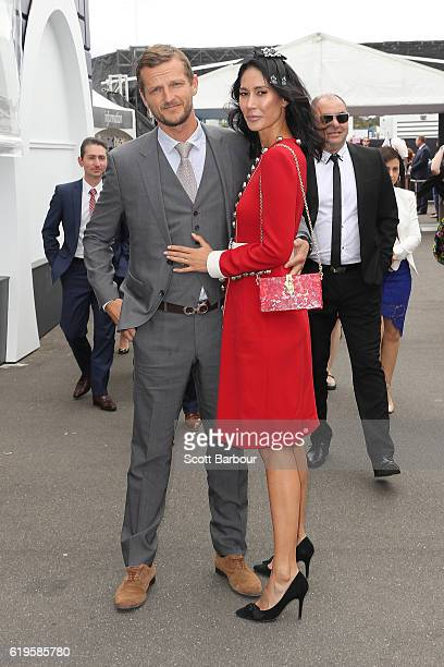 Adam Ellis and Lindy Klim pose at The Birdcage on Melbourne Cup Day at Flemington Racecourse on November 1 2016 in Melbourne Australia