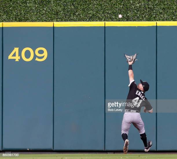Adam Engel of the Chicago White Sox attempts to make a catch on a line drive by Josh Reddick of the Houston Astros in the seventh inning at Minute...