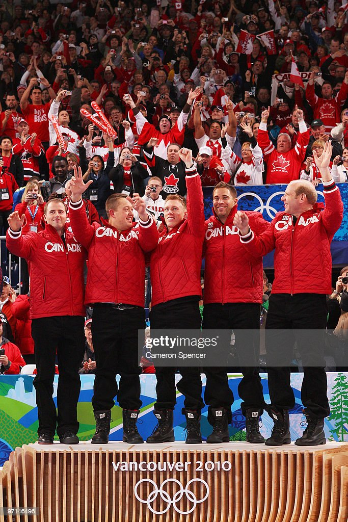 Adam Enright Ben Hebert Marc Kennedy John Morris and Kevin Martin of Canada reacts with their gold medals after the Curling Men's Gold medal game on...