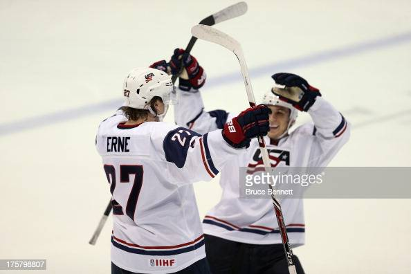 Adam Erne of Team USA celebrates his game winning shoot out goal against Team Finland during the 2013 USA Hockey Junior Evaluation Camp at the Lake...