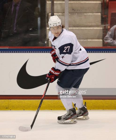 Adam Erne of Team USA skates against Team Sweden during the 2013 USA Hockey Junior Evaluation Camp at the Lake Placid Olympic Center on August 7 2013...
