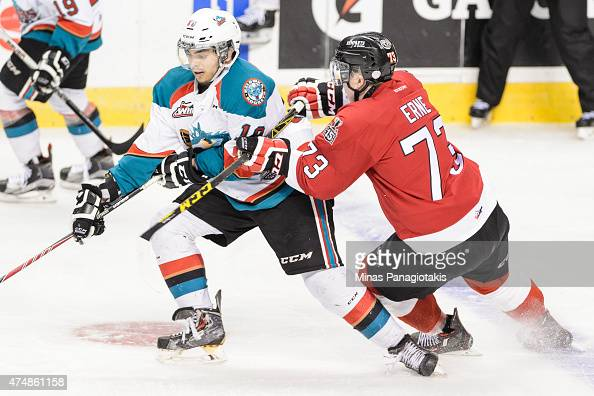 Adam Erne of the Quebec Remparts challenges Nick Merkley of the Kelowna Rockets in Game One during the 2015 Memorial Cup at the Pepsi Coliseum on May...