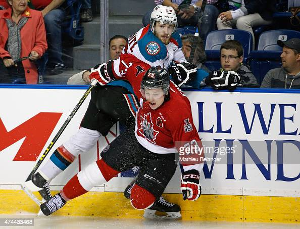 Adam Erne of the Quebec Remparts hits Leon Draisaitl of the Kelowna Rockets during the Memorial Cup CHL hockey game at the Colisee Pepsi on May 22...
