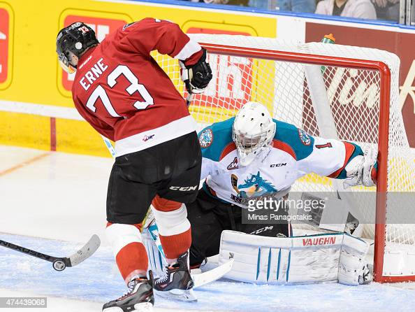 Adam Erne of the Quebec Remparts is unable to get a shot on goaltender Jackson Whistle of the Kelowna Rockets in Game One during the 2015 Memorial...