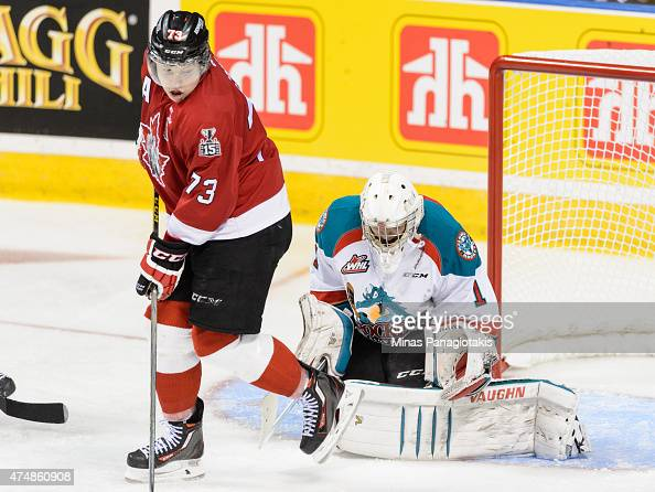 Adam Erne of the Quebec Remparts screens goaltender Jackson Whistle of the Kelowna Rockets in Game One during the 2015 Memorial Cup at the Pepsi...