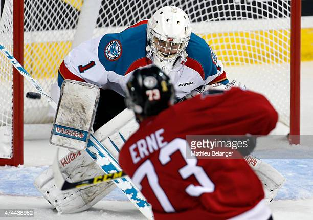 Adam Erne of the Quebec Remparts takes a shot on goalie Jackson Whistle of the Kelowna Rockets during the third period in Game One of the Memorial...
