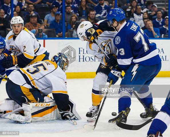 Adam Erne of the Tampa Bay Lightning attempts to score over the Nashville Predators Goalie Pekka Rinne during the third period at Amalie Arena on...