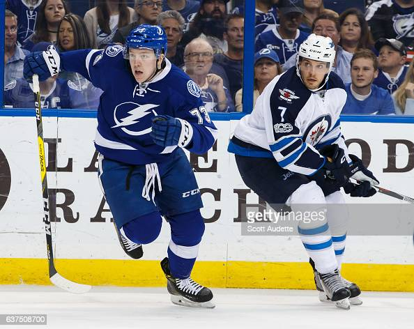 Adam Erne of the Tampa Bay Lightning skates against Ben Chiarot of the Winnipeg Jets during first period at Amalie Arena on January 3 2017 in Tampa...