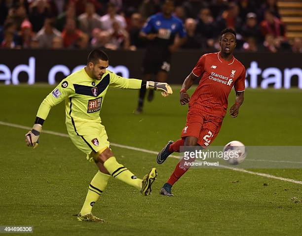 Adam Federici of AFC Bournemouth clears the ball from Divock Origi of Liverpool during the Capital One Cup Fourth Round match between Liverpool and...
