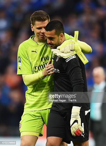 Adam Federici of Reading is consoled by Wojciech Szczesny of Arsenal after the team lost the FA Cup SemiFinal match between Arsenal and Reading at...