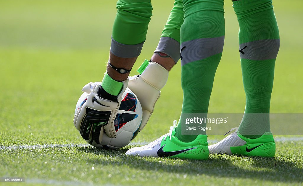 Adam Federici of Reading places the ball during the Barclays Premier League match between Reading and Stoke City at Madejski Stadium on August 18, 2012 in Reading, England.