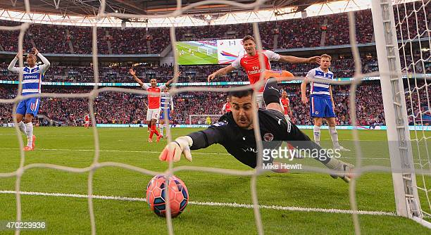 Adam Federici of Reading stretches for the ball as he fails to stop a shot by Alexis Sanchez of Arsenal for their second goal during the FA Cup Semi...