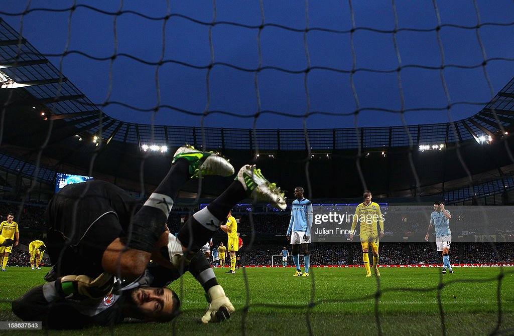 Adam Federici, the Reading goalkeeper rolls over after saving a shot during the Barclays Premier League match between Manchester City and Reading at Etihad Stadium on December 22, 2012 in Manchester, England.