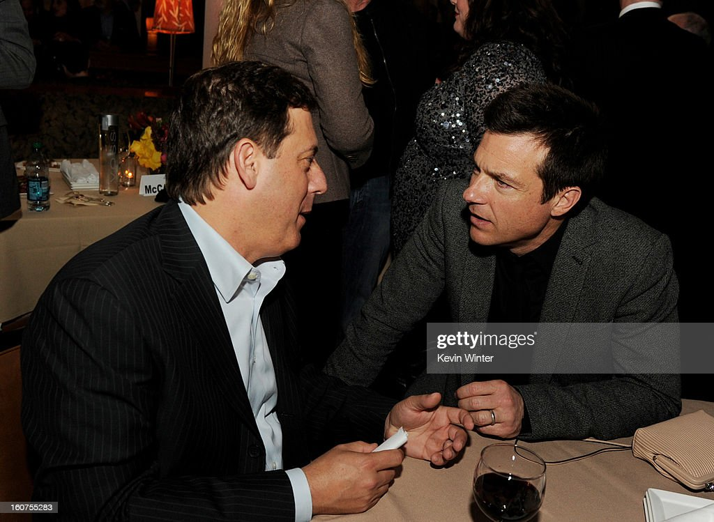 Adam Fogelson (L), Chairman, Universal Pictures and actor Jason Bateman talk at the after party for the premiere of Universal Pictures' 'Identity Thief' at Napa Valley Grille on February 4, 2013 in Los Angeles, California.