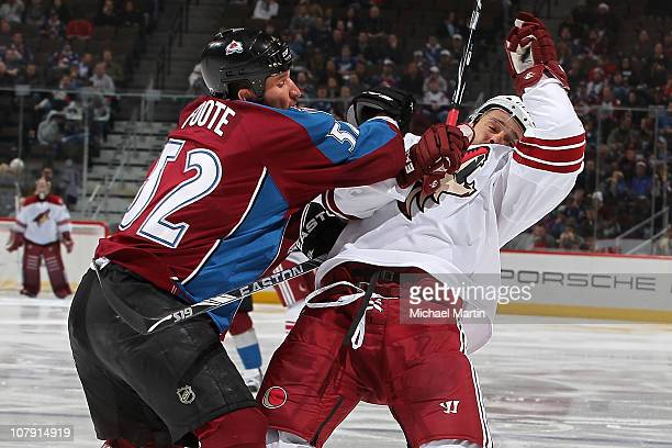 Adam Foote of the Colorado Avalanche checks Vernon Fiddler of the Phoenix Coyotes at the Pepsi Center on January 6 2011 in Denver Colorado