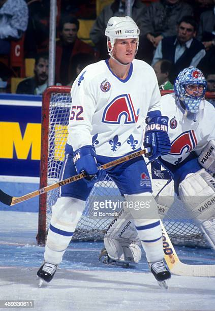 Adam Foote of the Quebec Nordiques defends during an NHL game in November 1992 at the Quebec Coliseum in Quebec City Quebec Canada