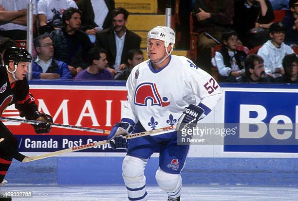 Adam Foote of the Quebec Nordiques skates on the ice against the Ottawa Senators on October 10 1992 at the Quebec Coliseum in Quebec City Quebec...