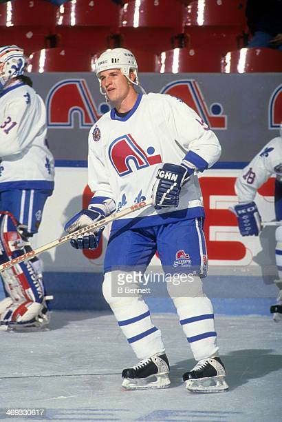 Adam Foote of the Quebec Nordiques skates on the ice before an NHL game in November 1992 at the Quebec Coliseum in Quebec City Quebec Canada