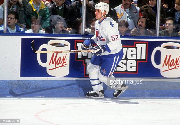 Adam Foote of the Quebec Nordiques skates on the ice during an NHL game in November 1992 at the Quebec Coliseum in Quebec City Quebec Canada