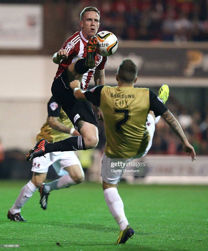 Adam Forshaw of Brentford beats Dean Cox of Leyton Orient to the ball in the air during the Sky Bet League Once match between Brentford and Leyton Orient at Griffin Park on September 23, 2013 in Brentford, England.