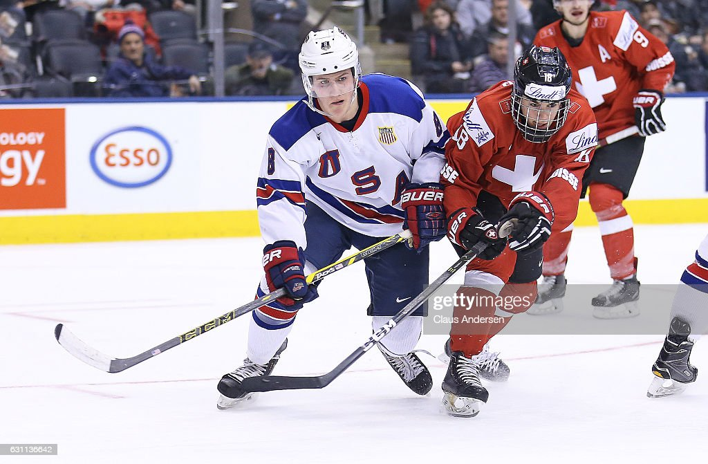 Adam Fox #8 of Team USA skates against Nico Hischier #18 of Team Switzerland during a QuarterFinal game at the 2017 IIHF World Junior Hockey Championships at Air Canada Centre on January 2, 2017 in Toronto, Ontario, Canada. Team USA defeated Team Switzerland 3-2.