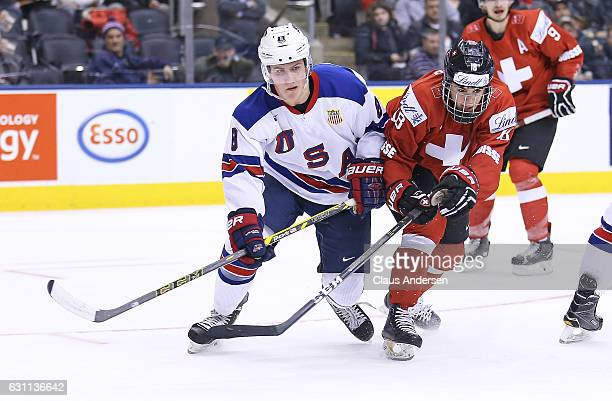 Adam Fox of Team USA skates against Nico Hischier of Team Switzerland during a QuarterFinal game at the 2017 IIHF World Junior Hockey Championships...