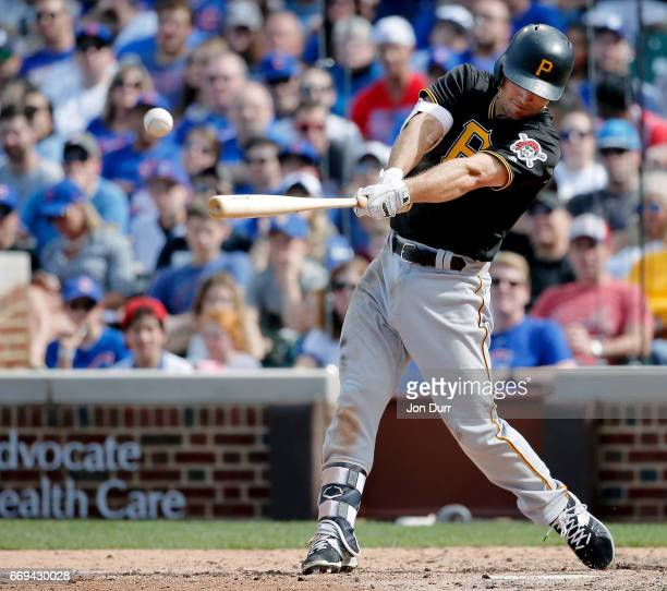 Adam Frazier of the Pittsburgh Pirates at bat against the Chicago Cubs during the eighth inning at Wrigley Field on April 16 2017 in Chicago Illinois...