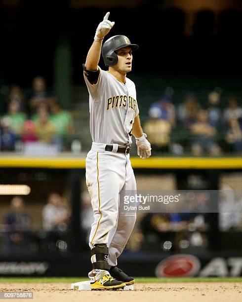 Adam Frazier of the Pittsburgh Pirates celebrates after hitting a double in the fifth inning against the Milwaukee Brewers at Miller Park on...