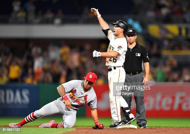 Adam Frazier of the Pittsburgh Pirates celebrates after hitting a double during the ninth inning against the St Louis Cardinals at PNC Park on July...