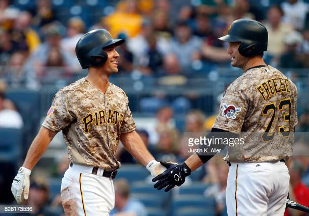 Adam Frazier of the Pittsburgh Pirates celebrates after scoring on a ground out against the Cincinnati Reds at PNC Park on August 3 2017 in...