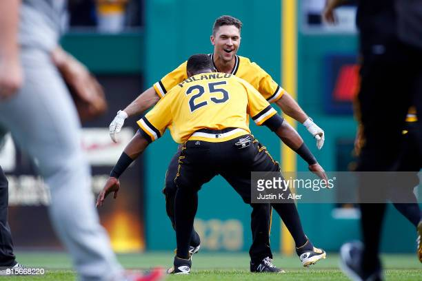 Adam Frazier of the Pittsburgh Pirates celebrates his walk off single in the ninth inning against the St Louis Cardinals at PNC Park on July 16 2017...