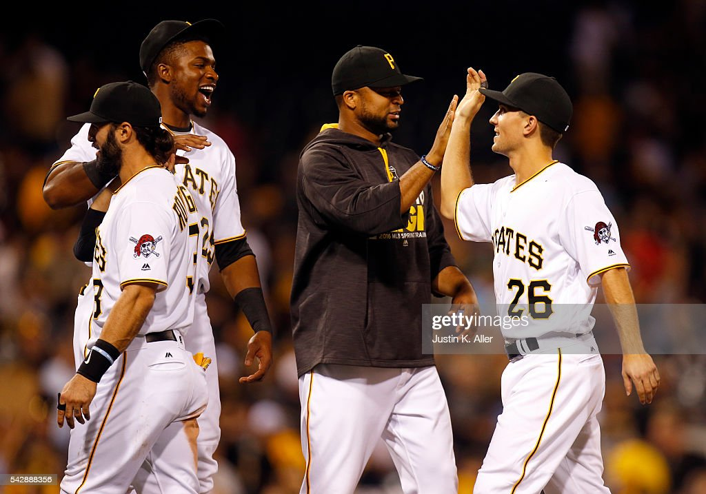 Adam Frazier #26 of the Pittsburgh Pirates celebrates with <a gi-track='captionPersonalityLinkClicked' href=/galleries/search?phrase=Francisco+Liriano&family=editorial&specificpeople=580400 ng-click='$event.stopPropagation()'>Francisco Liriano</a> #47 and <a gi-track='captionPersonalityLinkClicked' href=/galleries/search?phrase=Gregory+Polanco&family=editorial&specificpeople=11178456 ng-click='$event.stopPropagation()'>Gregory Polanco</a> #25 after defeating the Los Angeles Dodgers 8-6 at PNC Park on June 24, 2016 in Pittsburgh, Pennsylvania.