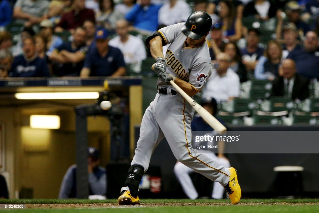 Adam Frazier #26 of the Pittsburgh Pirates hits a single in the seventh inning against the Milwaukee Brewers at Miller Park on September 12, 2017 in Milwaukee, Wisconsin.