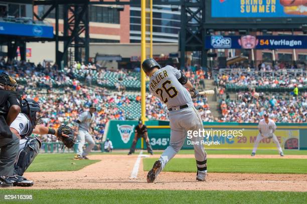 Adam Frazier of the Pittsburgh Pirates hits a two run RBI double in the fourth inning against the Detroit Tigers during a MLB game at Comerica Park...