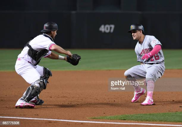 Adam Frazier of the Pittsburgh Pirates is tagged out by Jeff Mathis of the Arizona Diamondbacks after getting caught in a run down between second and...