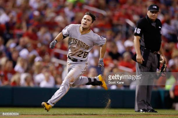 Adam Frazier of the Pittsburgh Pirates runs for home plate after hitting an insidethepark home run during the seventh inning against the St Louis...