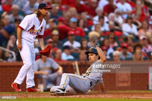 Adam Frazier of the Pittsburgh Pirates scores a run against the St Louis Cardinals in the third inning at Busch Stadium on June 25 2017 in St Louis...