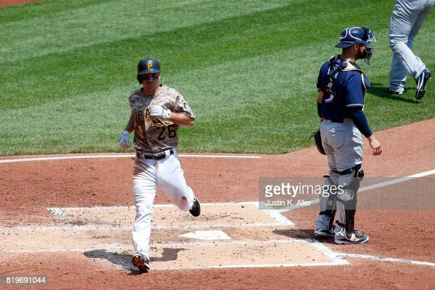 Adam Frazier of the Pittsburgh Pirates scores on a RBI single in the second inning against the Milwaukee Brewers at PNC Park on July 20 2017 in...