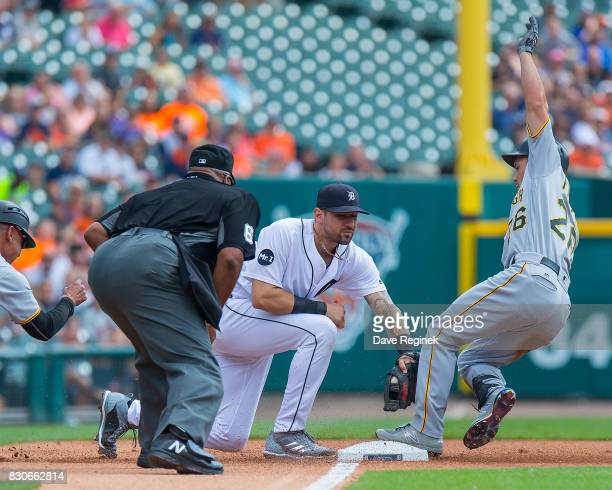 Adam Frazier of the Pittsburgh Pirates slides into third base and beats the tag by Nicholas Castellanos of the Detroit Tigers during a MLB game at...