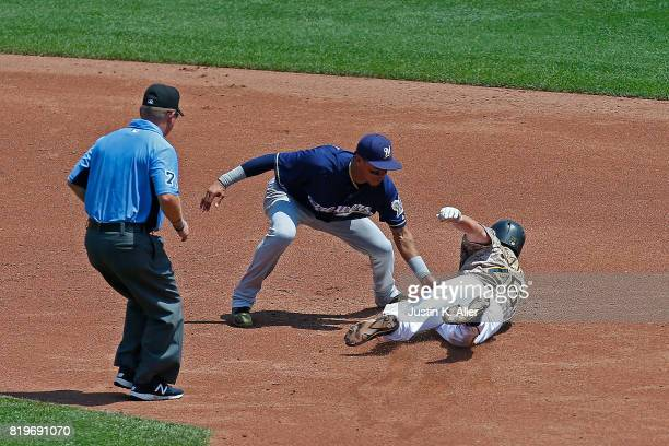 Adam Frazier of the Pittsburgh Pirates steals second base against Orlando Arcia of the Milwaukee Brewers in the second inning at PNC Park on July 20...