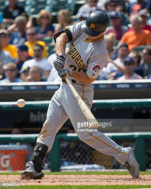 Adam Frazier of the Pittsburgh Pirates swings and makes contact against the Detroit Tigers during a MLB game at Comerica Park on August 10 2017 in...
