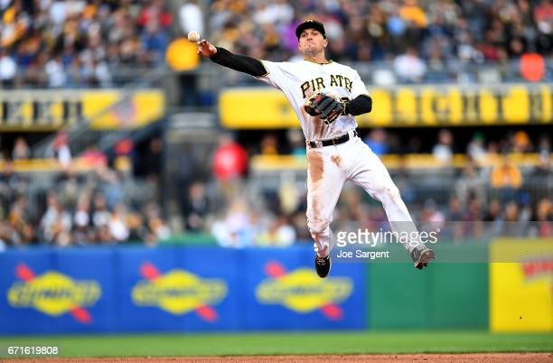 Adam Frazier of the Pittsburgh Pirates throws over to first base during the sixth inning against the New York Yankees at PNC Park on April 22 2017 in...